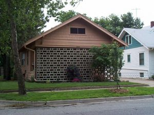 This 1960's masonry screenwall presents an austere face to the street in stark contrast to the open and inviting porch so typical of Craftsman-style bungalows. It is now old enough to be in vogue again.